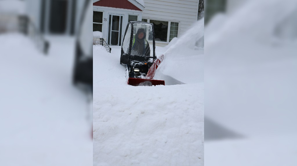 John Moore of Miramichi clears his driveway after a snowstorm in this file photo.