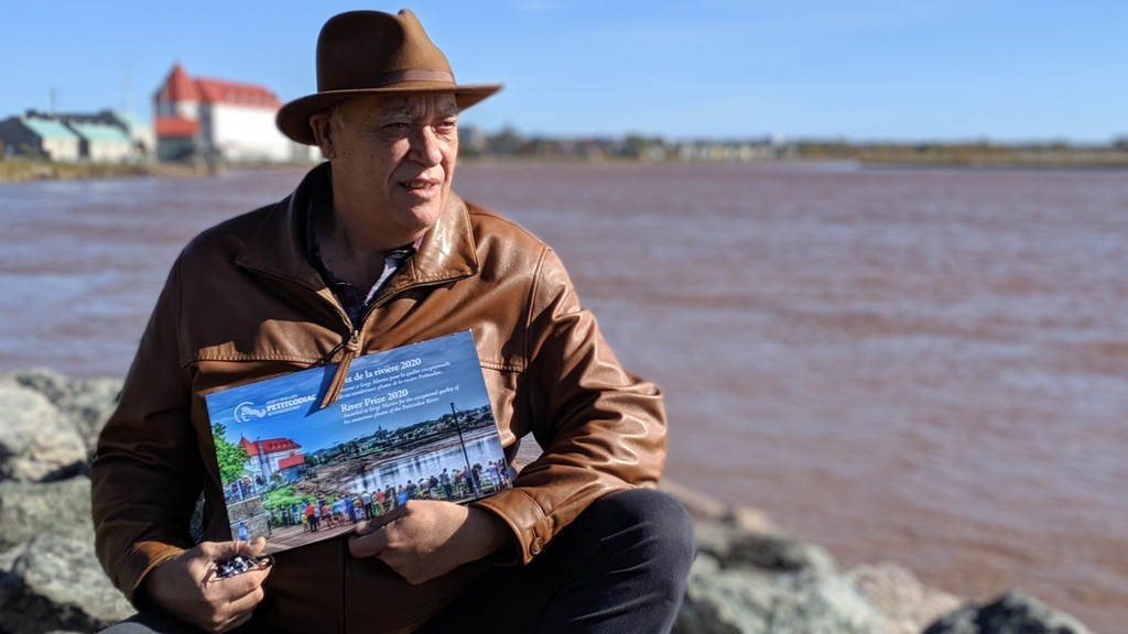 Serge Martin has walked along the Petitcodiac River just about every day for the last seven years, taking photos  and videos of the Tidal Bore. The Petitcodiac Riverkeeper environmental group presented him with an award of recognition Friday.