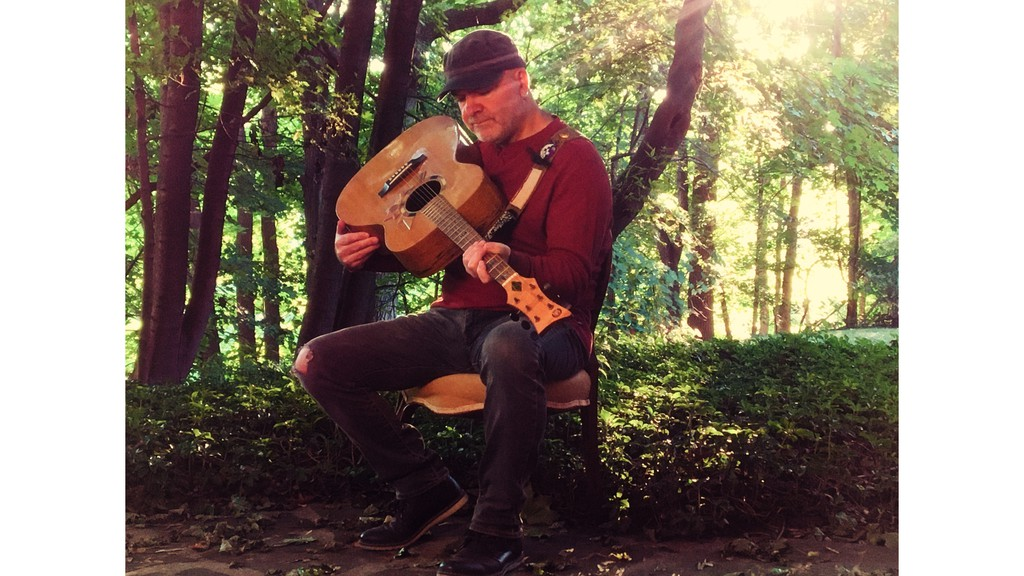 Scottish-Canadian musician David Leask holds the Six-String Nation Guitar dubbed Voyageur. Leask used the instrument, which incorporates 64 pieces of Canadian historic sites and artifacts, to record his new concept record Voyageur in Song.