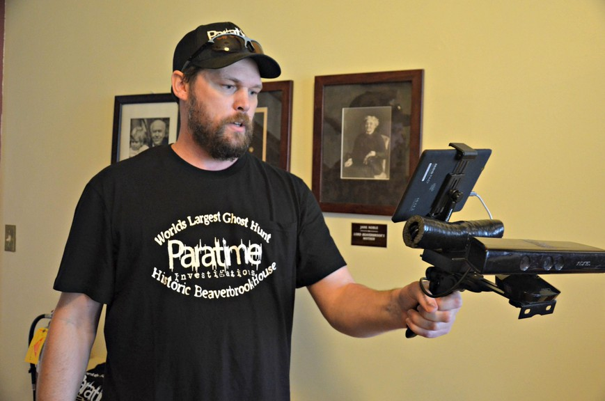 Doug Curtis, left, co-owner of Paratime Investigations, tests some ghost-hunting equipment Sept. 26 at Historic Beaverbrook House in Miramichi.