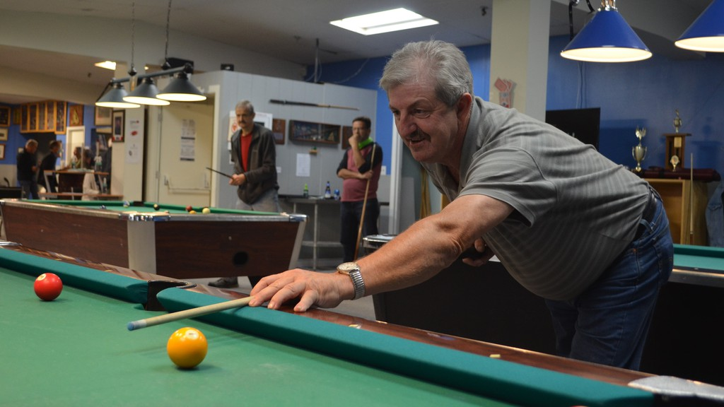 Royal Canadian Legion executives in New Brunswick say smaller branches are especially in need of financial aid due to constraints caused by the COVID-19 pandemic. Plemon Mercer plays pool at the Royal Canadian Legion Branch No. 4 in Fredericton, which has remained in good shape despite the pandemic.