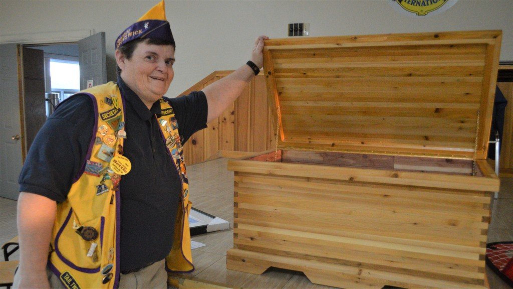 Laura Clark of the Tobique Lions Club shows off a handmade chest at the 2019 auction. This year, the club will host a silent auction on Oct. 24 at the Tobique Lions Community Centre in Plaster Rock.