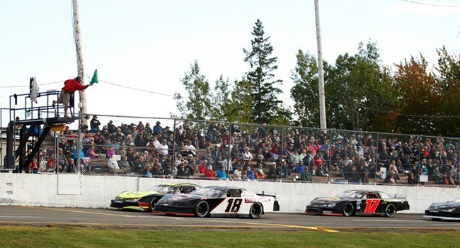 Spectators watch a pro stock race at the Mike Stevens Memorial event at Petty International Raceway in River Glade last month.