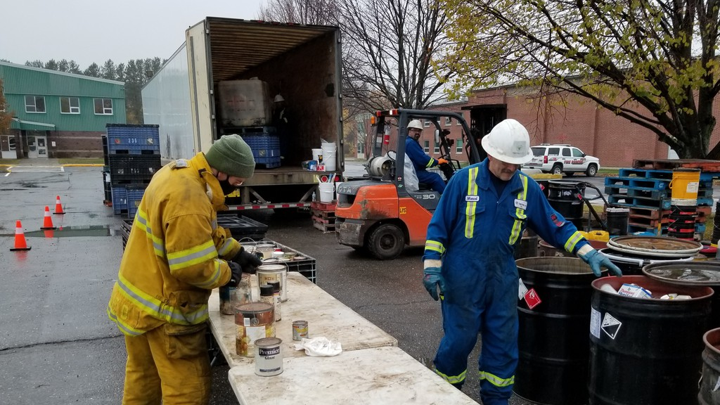 Perth-Andover firefighters and Terrapure Environmental employees sort through materials at the Household Hazard Waste event in Perth-Andover Saturday.