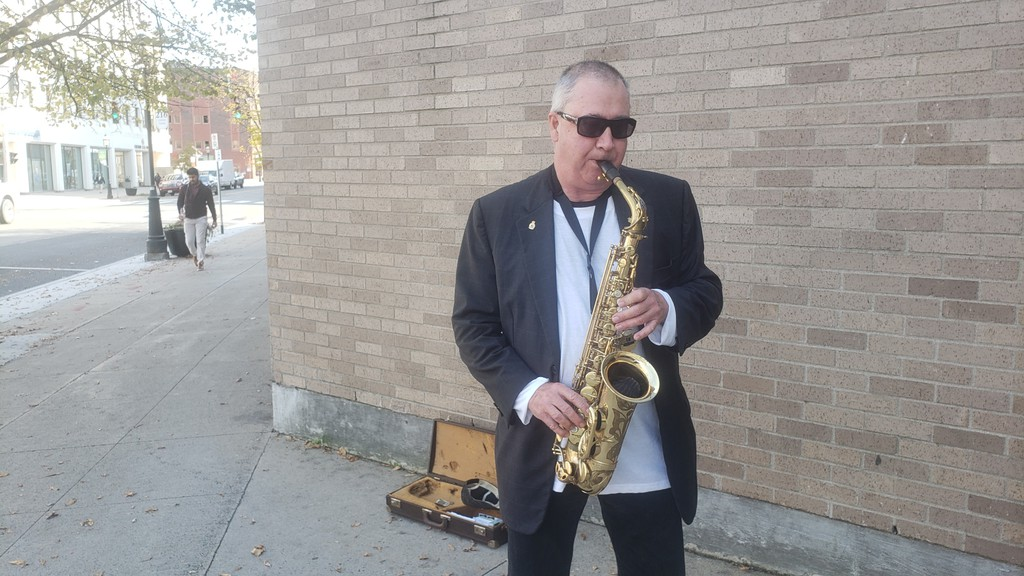 Nick Perrin plays his saxophone on King Street in Fredericton.