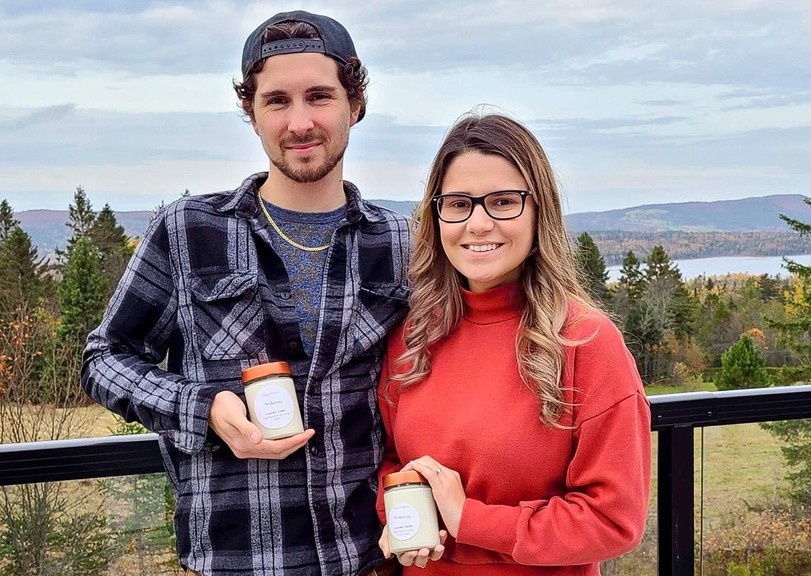 Logan Bishop, left, and Genevieve Crowell are donating 50 per cent of the profits from the sale of their handmade candles called Wolastoq to the Sipekne'katik First Nation in Nova Scotia. Wolastoq is the Maliseet word for the St. John River.