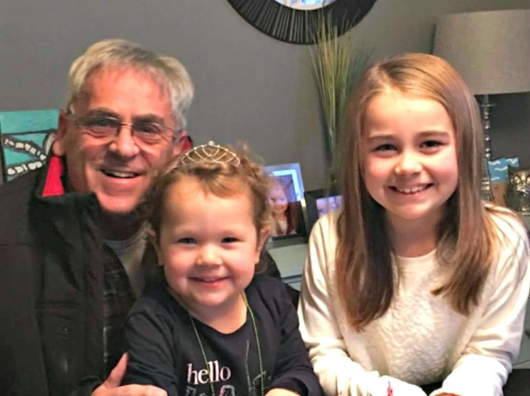 Rhéal Vautour is pictured with his granddaughters Alexis and Olivia. Vautour died from complications of COVID-19 on Oct. 20, according to his son Mark. The province confirmed the death of a man in his 70s was linked to COVID-19.