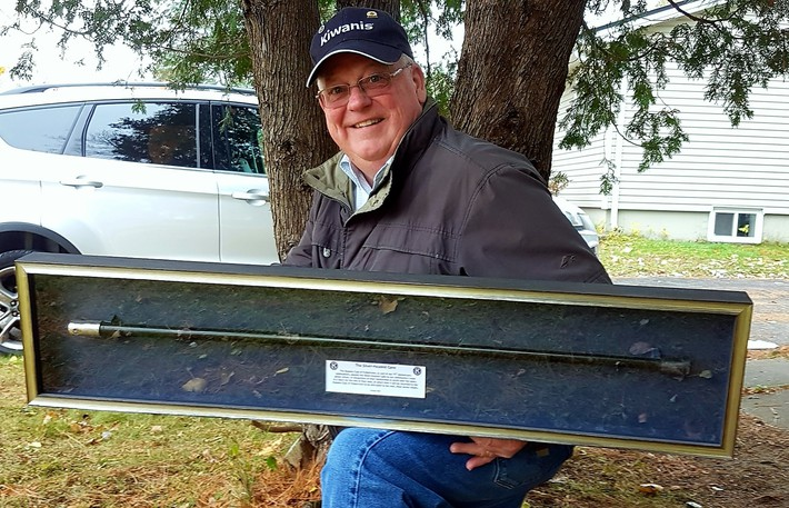 Kiwanis Club of Fredericton president Mike Ross holds the Silver Headed Cane in this file photo. The club is searching for its second guardian of the cane following the death in July of its inaugural holder.