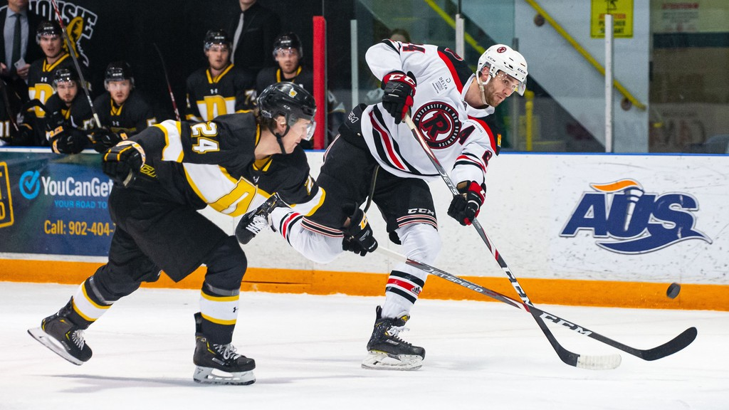 UNB Reds centre Mark Simpson, shown in action against the Dalhousie Tigers in January, has signed with the American Hockey League's Stockton Heat.