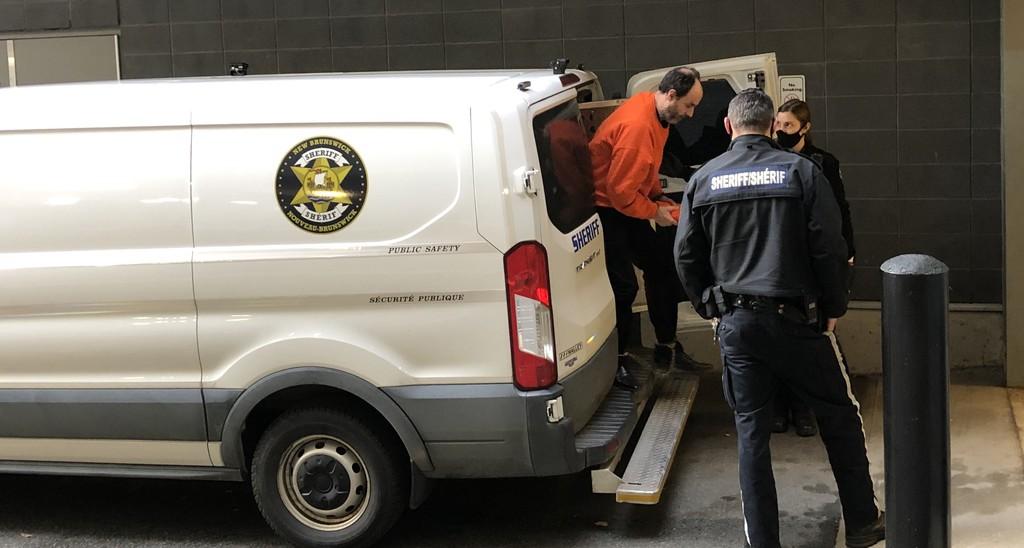 Matthew Raymond arrives at court for his murder trial Thursday.