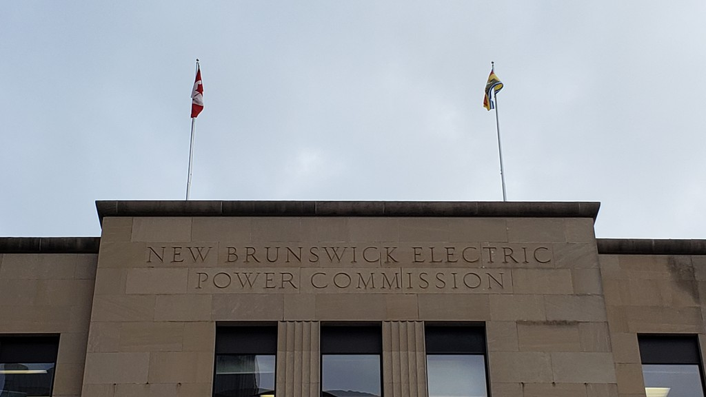 The old NB Power office building in downtown Fredericton. The pandemic has caused some of the public utility's investment funds to sour.