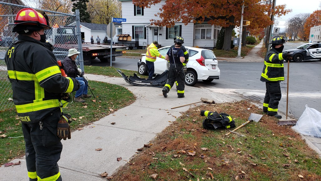 Fredericton firefighters clean up a two-car wreck at the corner of Smythe and Saunders streets Friday morning.