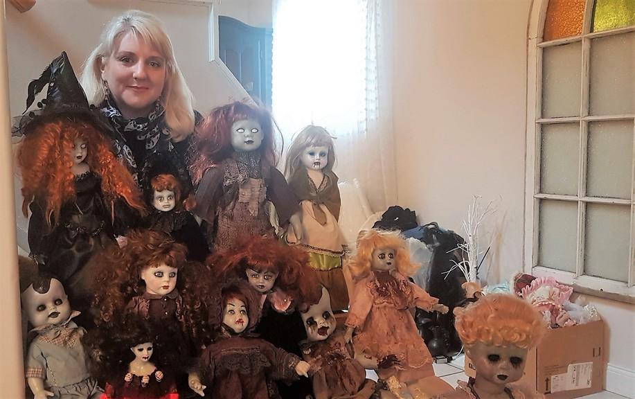 Fredericton's Shannon Browne is surrounded by her collection of creepy porcelain dolls. Her creations have been a big hit as Halloween approaches.