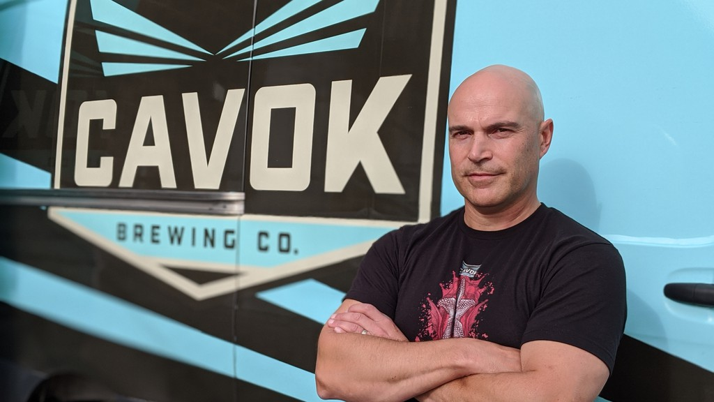 Serge Basque, co-owner of CAVOK Brewing Co., stands in front of one of his trucks at their brewery and taproom in Dieppe. Basque and co-owner Serge Nadeau are concerned a new initiative from NB Liquor will cut into their profits.