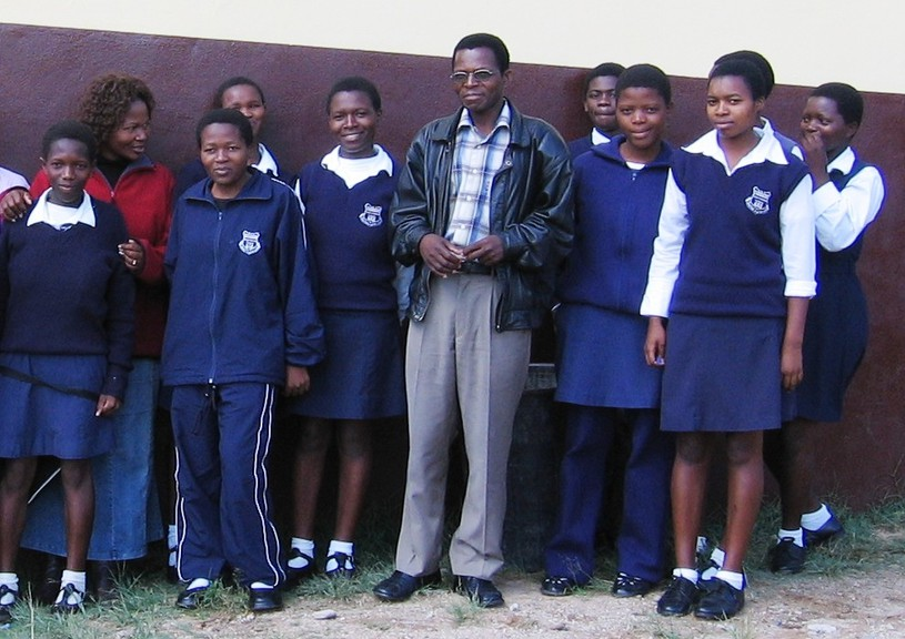 The head teacher and students at the Hampton-Piggs Peak Partnership school are seen in this photo. Mark Bettle writes about the partnership's efforts to alleviate the challenges women and girls face in Swaziland, in this week's column.
