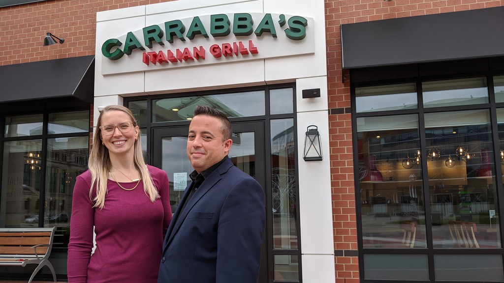Front house manager Brooke McGovern and general manger Sébastien Ledoux stand outside Carrabba's Italian Grill in Moncton on Friday afternoon. The restaurant, located inside the Hyatt Place Moncton/Downtown, opens on Monday.