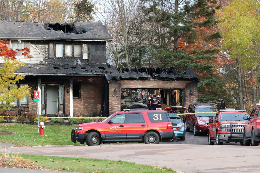Dieppe fire investigators work at the scene of a fire on Pabineau Court, near Centrale Street.