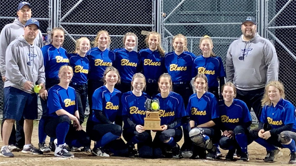 The Oromocto High School Blues AAA girls softball team poses with the Western Conference trophy after defeating the Fredericton High School Black Kats 12-5 in a sudden-death final. Team members include, front row, from left, assistant coach Laurie Muise, Felicity Kirkby, Jayden Barrieau, Chloe McLaughlin, Brooke Tracy, Sierra Tracy, Brooke Maxwell and Kennedy Shannon; back row, from left, head coach Jeremy Tracy, Madison Bagnall, Emma Gallant, Katelynn Rowe, Emma Johnson, Carly Muise, Emily Rowe, Lauren Brewer and assistant coach Dan Mersereau.