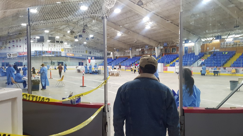 People are pictured waiting to be tested for the COVID-19 virus at the Inch Arran Ice Palace in Dalhousie on Oct. 25. Health Department spokesman Bruce MacFarlane said Monday that about 1,300 tests were done in Campbellton on Oct. 24 and about 1,100 in Dalhousie on Oct. 25.