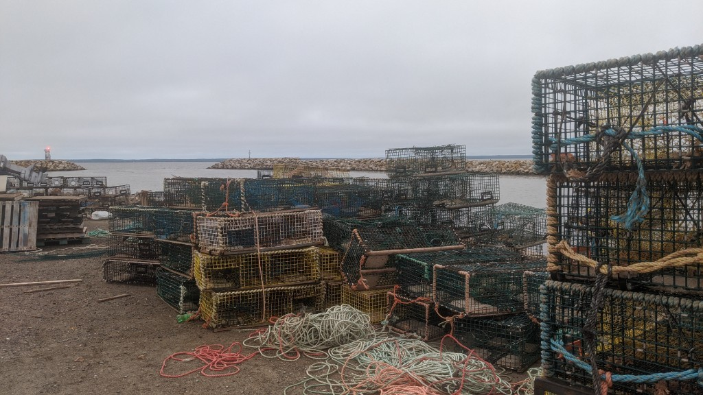 Lobster traps are shown on Saturday stacked on the wharf at Saulnierville, N.S., the site of a contentious self-regulated lobster fishery launched in September by Sipekne'katik First Nation.