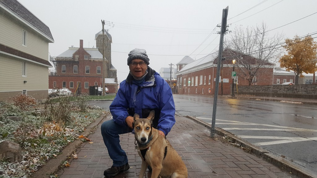 Philippe Hachey took his dog for a walk in downtown Bathurst on Monday evening, enjoying the first snowfall of the season.