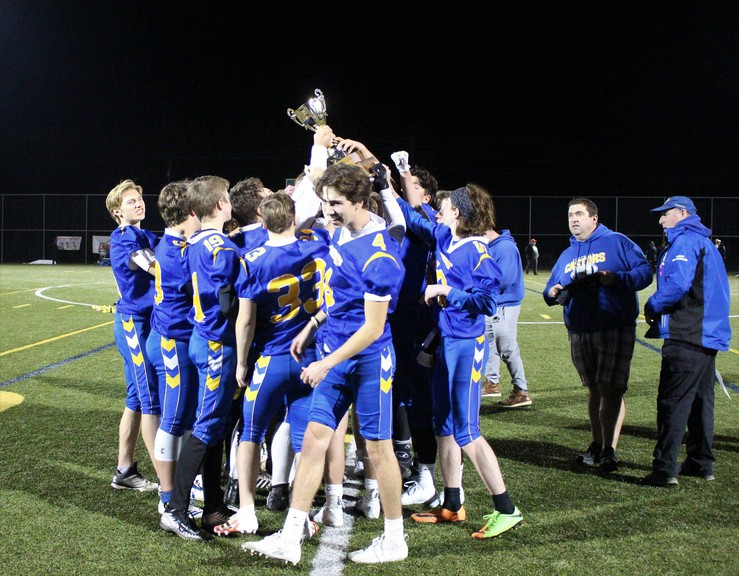 The Ecole Sainte-Anne Castors celebrate their Western Conference flag football championship after a 36-26 victory over the Fredericton High School Black Kats in the championship game Friday night at Scotiabank Park South.
