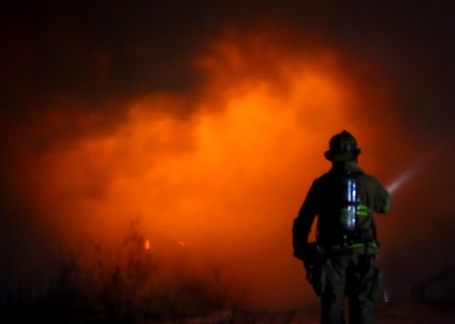 A file photo of a firefighter from Petitcodiac Fire and Rescue. A man was killed in a blaze at a single family dwelling in Petitcodiac Monday night.