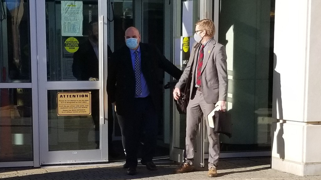 Mark A. McAloon, left, exits the Saint John Law Courts on Tuesday morning with his lawyer Charles Bryant after being acquitted of sexual assault.