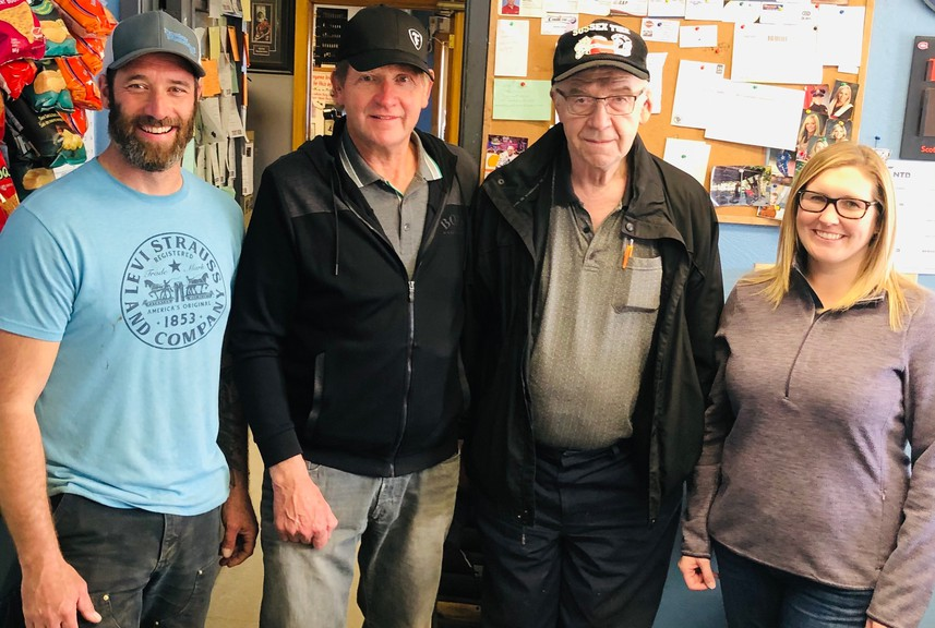 From left, Cory Proctor, Don Titus, Ernie Titus and Martha Proctor pose for a photo the day the business, Sussex Tire Service, changed hands from the Titus brothers to the Proctor family in mid-October.