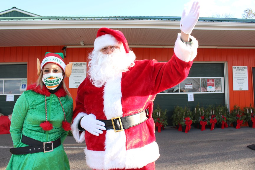 Amanda Cole, market manager of Cochran's Country Market, along with Santa Claus and Mrs. Claus, will be passing out treat bags at Cochran's Country Market Saturday from 3 to 6 p.m.