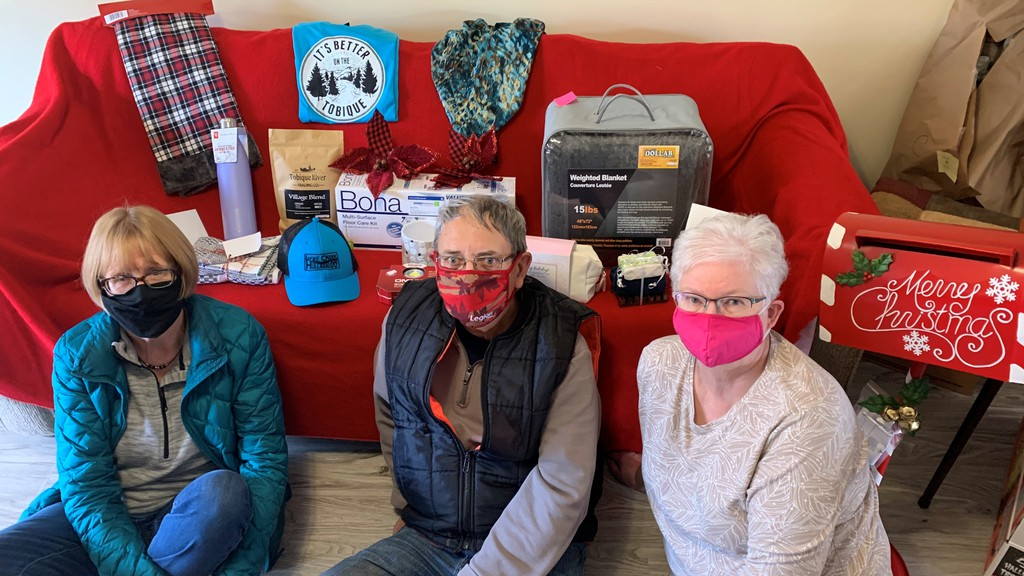Pictured are members of the Rotary Club of Perth-Andover. From left, Patria Hebert, John Larsen and Marsha Lang, with some of the items included in the Mystery Draw fundraiser. Tickets on 10 prize bundles each worth more than $600 plus a $100 bill will be drawn Dec. 3 at a virtual event.