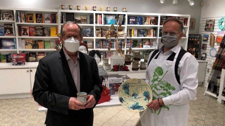 New Brunswick Museum CEO Bill Hicks, and Saint John-Rothesay MP Wayne Long explore the museum's gift shop. Part of a $92,250 grant from the federal government will go towards the gift shop's digital marketing.