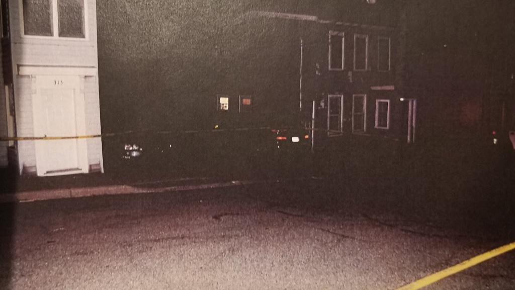 One of the photographs officer Connor Bodechon took after the shooting of Mark Shatford. The image -- a photocopy of a printed photograph -- is lower quality than Bodechon normally would have to present to a jury, but he said the recent cyber attack on the city means he can't access the raw images on his computer.