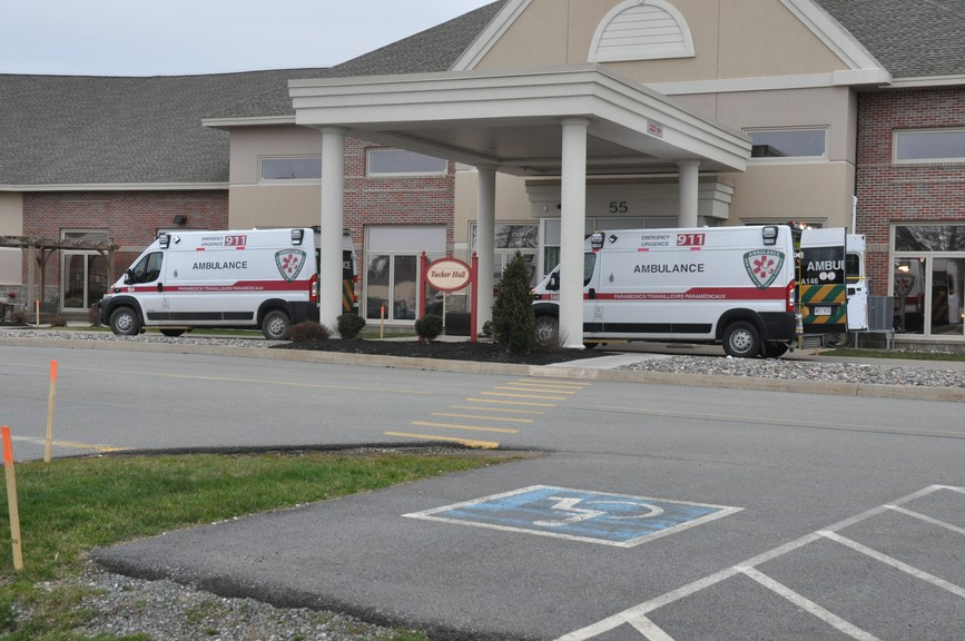 Ambulances are pictured here outside of Shannex's Parkland Saint John facility Friday. An outbreak has been declared at the nursing home.