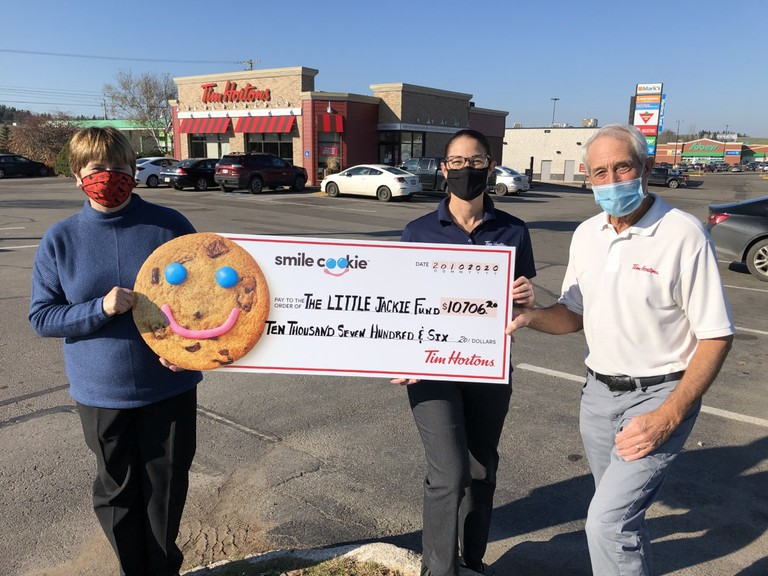 From left: Little Jackie Fund board member Joanne Lucas, Tim Hortons manager Meghan Wong, and Tim Hortons Sussex owner Jim Andrew show off a cheque for more than $10,000 raised for the charity through the restaurant's smile cookie promotion.