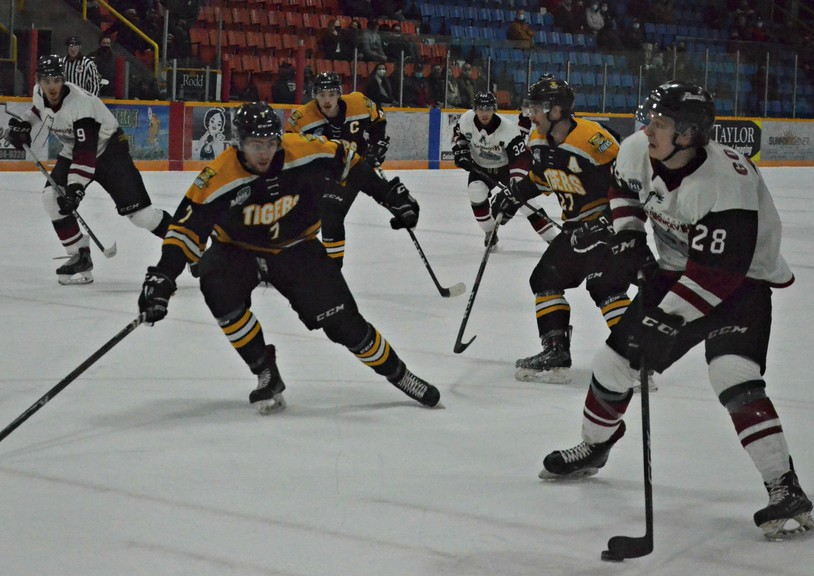 Miramichi Timberwolves forward Matt Gordon, 28, aims a shot past Campbellton Tigers defenceman Liam Best, 7, during Maritime Junior Hockey League play Nov. 21 at Miramichi Civic Centre. Gordon notched a hat trick in the Wolves' 8-3 victory.