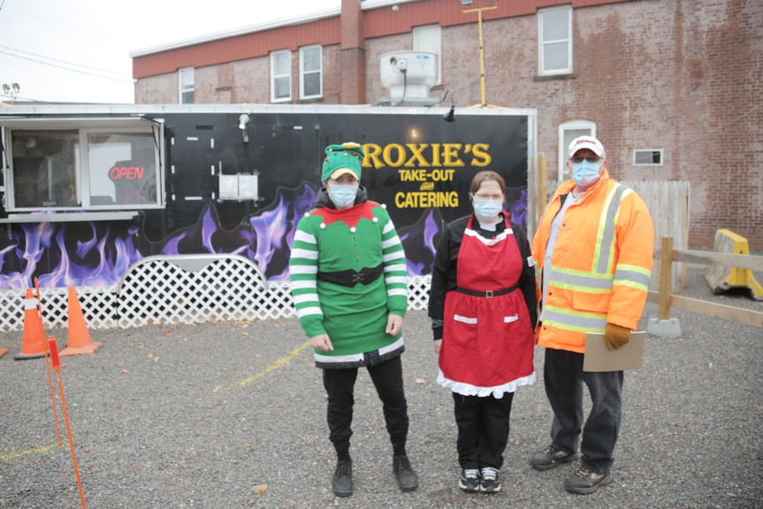 From left, Roxie's employees Sam Meyers and Stephanie Wade pose for a photo with owner Don MacLellan on Wednesday. In mid-November, the owner of the mobile eatery was denied a request to make the business permanent.