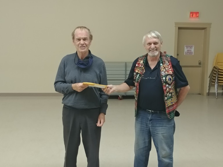 On Nov. 10, King Lion Glenn Day, right,  presented Terry Delaney with a Builder's Pin, in recognition of his involvement in different committees throughout the years with the Campbellton Lions Club.