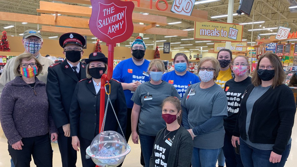 Woodstock Mayor Art Slipp and wife Lynne Slipp, and Salvation Army Majors Angel and Marlene Sandoval, on the left, pose for a photo with Woodstock Superstore employees for the 2020 launch of the Christmas kettle campaign on Thursday, Nov. 26.