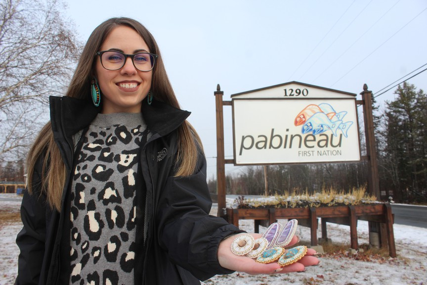 Pabineau First Nation's Stephanie Peter-Paul is one of the many Indigenous women entrepreneurs from across New Brunswick who are part of Nujintuisga'tijig E'pijig, which is an online platform recently launched by Women in Business New Brunswick. She's pictured here holding some of the beaded earrings she makes and is selling via the site.