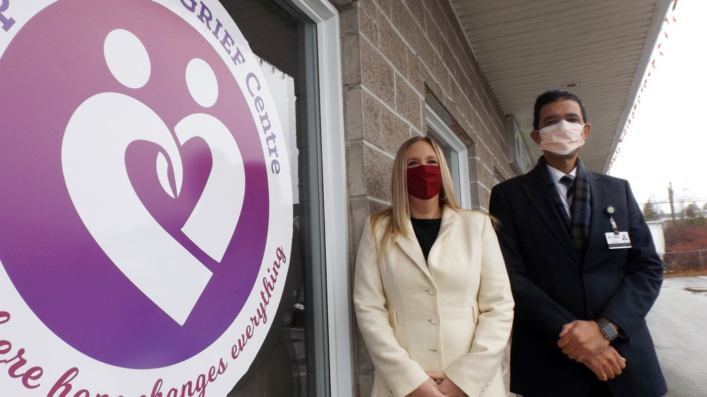 Jamie Godfrey, board chairwoman, and Dr. Tamer Rizk, vice-chairman, stand out front of the new Compassionate Grief Centre in Rothesay. The centre will start offering grief counselling sessions in December.