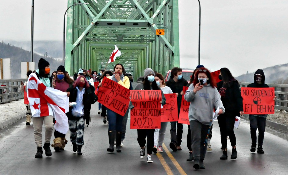 About 100 people, mostly students and parents from Listuguj, walked peacefully across the J.C. Van Horne Bridge linking Campbellton to Quebec on Friday to protest the lack of student access to Sugarloaf Senior High School. Social distancing was mostly maintained and everyone was wearing a mask.