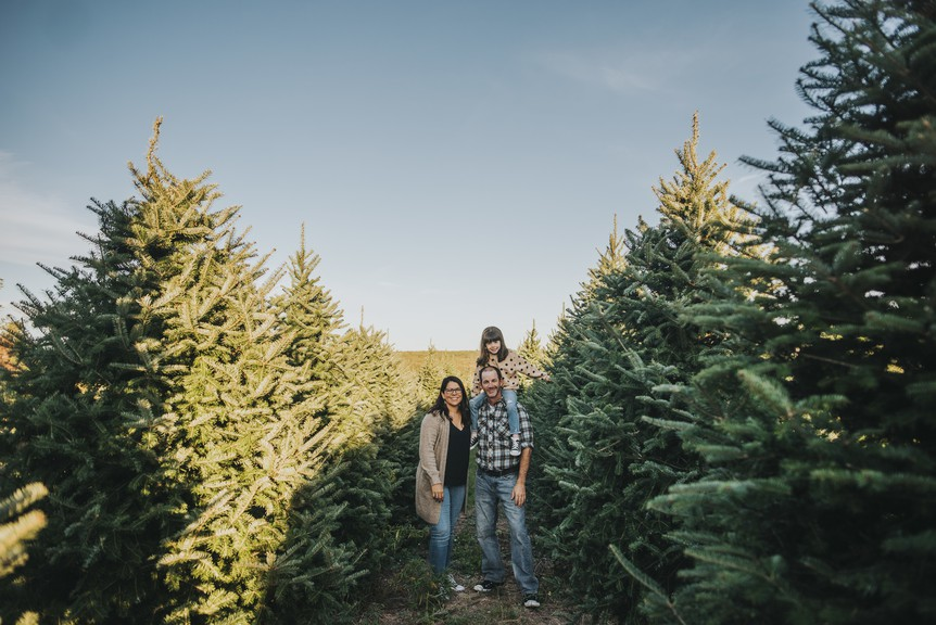 Lo-Hi Christmas Tree Farm operators Tracey Paul Kirkpatrick, David Kirkpatrick and their daughter, Daisy.