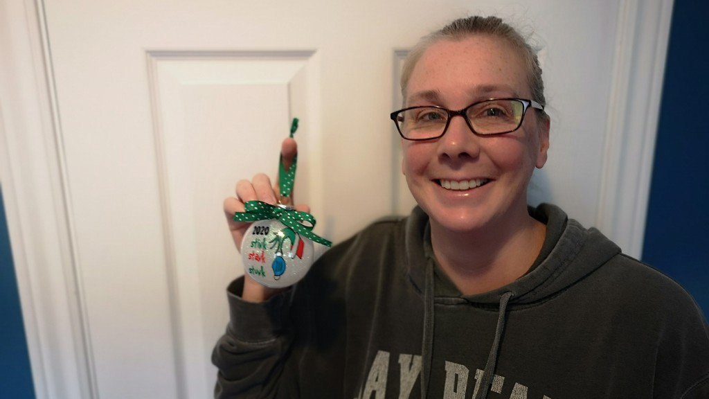 "Julie Soucy, owner of Julie's Cricut Crafts, is making and selling custom ornaments with ""2020 Stink Stank Stunk"" written on them as a way to help people have a bit of fun during a year filled with negativity."