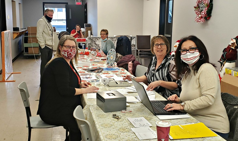 Volunteers manned the phones and tallied the donations at the RCVAA's headquarters Sunday during a radiothon that collected more than $37,000 for families in need throughout Restigouche.