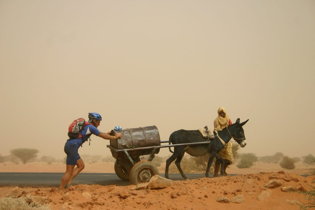 rider-in-Sudan-helping-out-1024x683