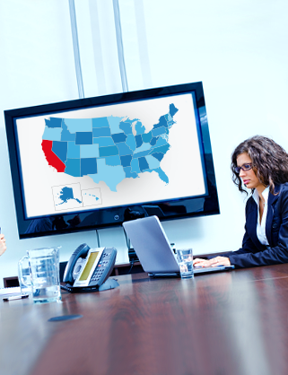 Map of California and woman at desk