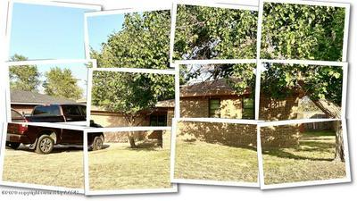 1009 MORTON AVE, Dumas, TX 79029 - Photo 1