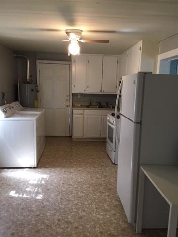 407 W RIO GRANDE ST, Taylor, TX 76574 - Photo 1