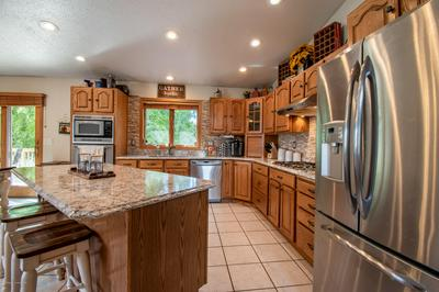 1306 9TH ST E, Dickinson, ND 58601 - Photo 2